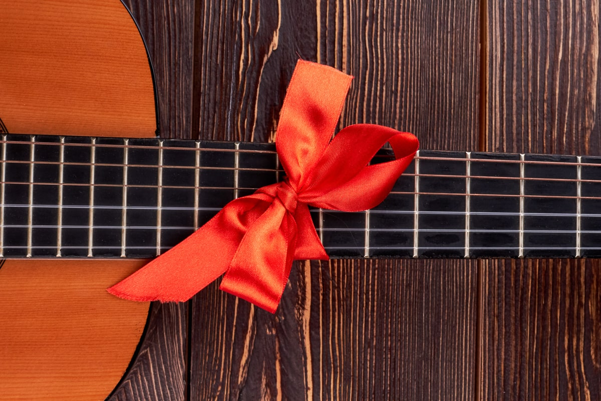 red ribbon on guitar neck best gifts for guitar players