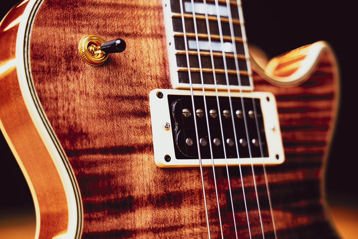 shiny wooden electric guitar body with strings