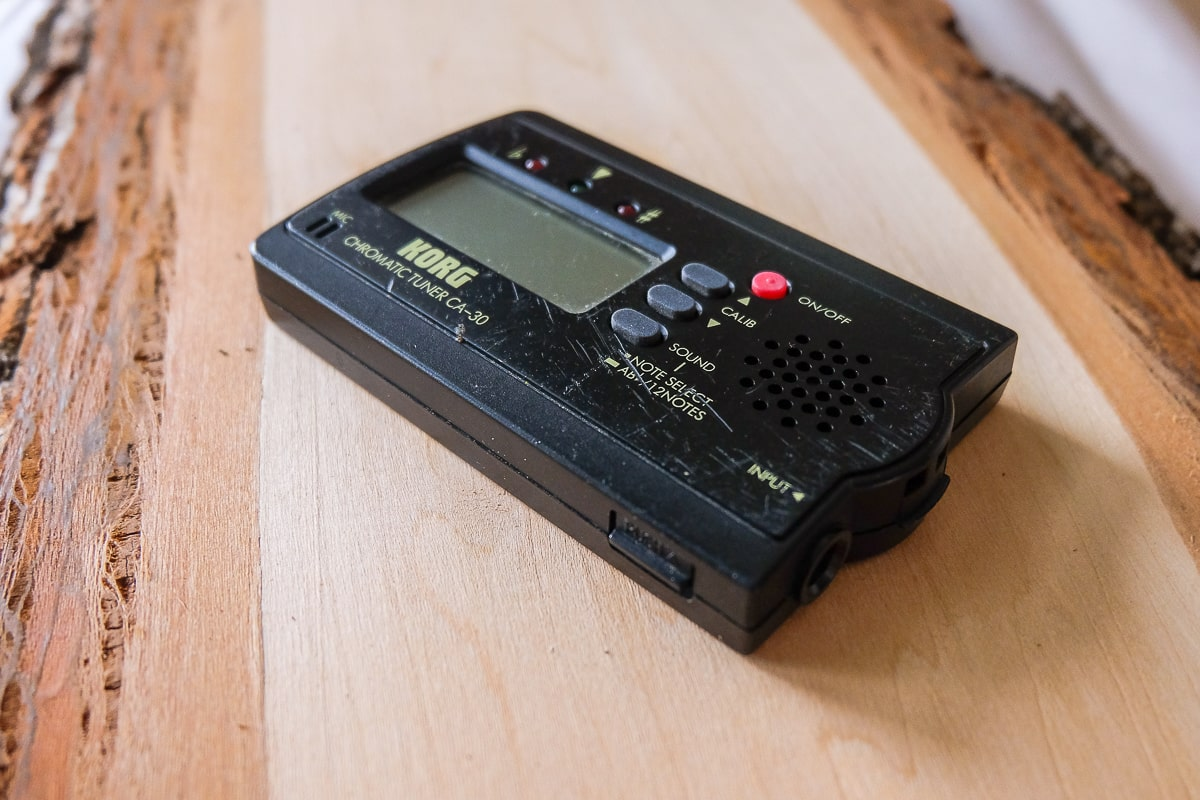 black guitar tuner on wooden table